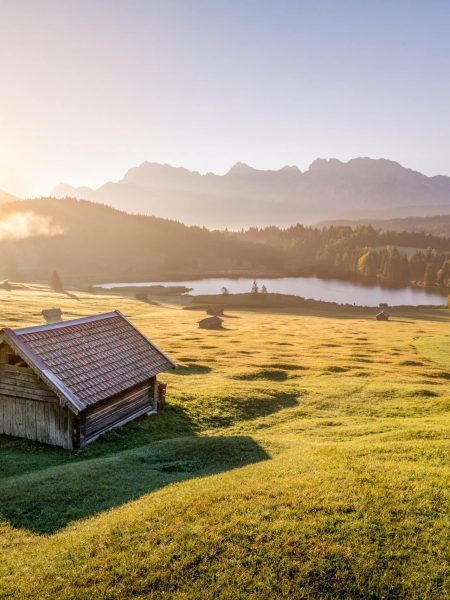 View Over Geroldsee With Wooden Hut And Karwendel Mountains At Morning, Bavaria, Germany